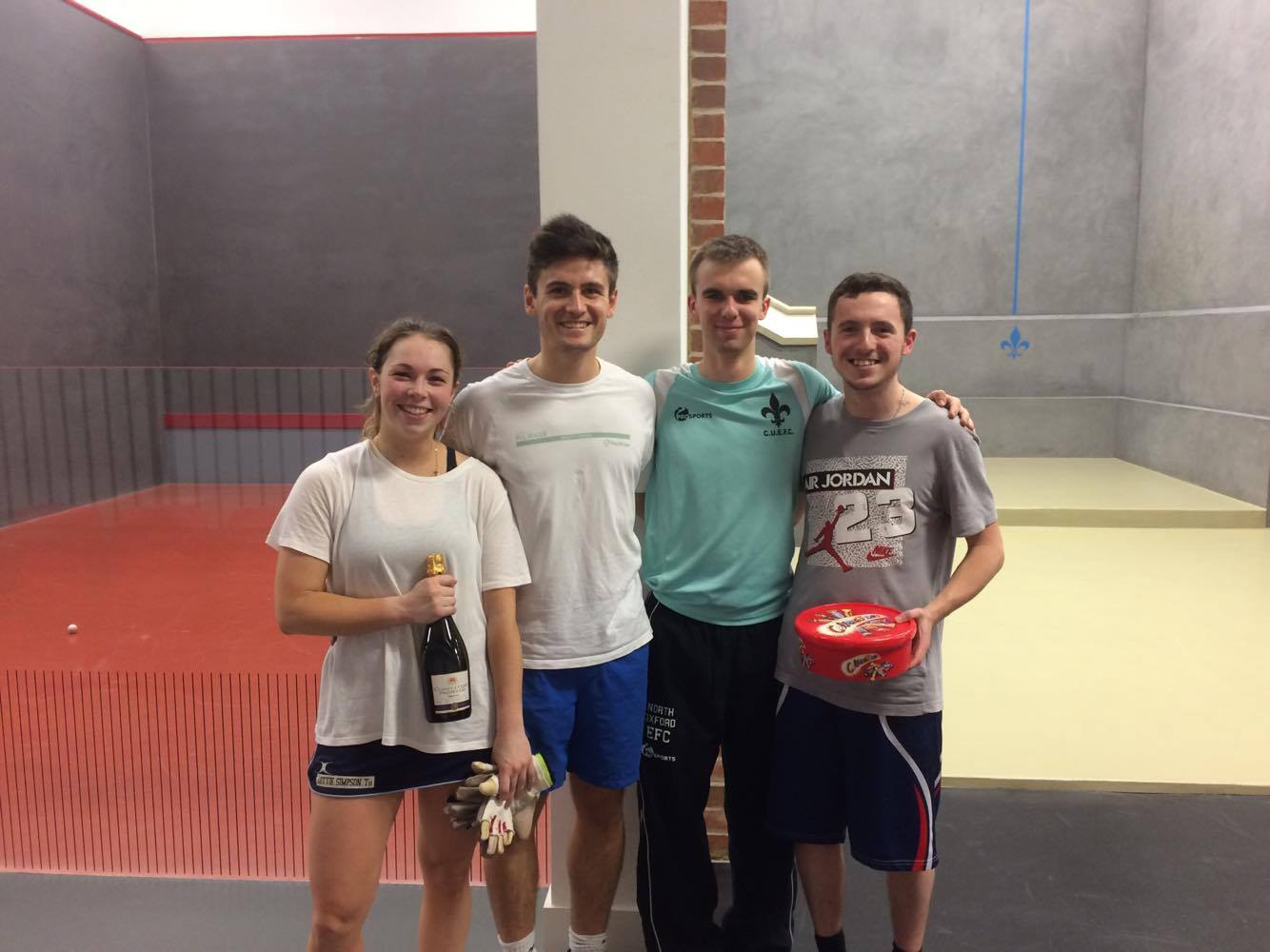 Winners with the two university captains of Fives